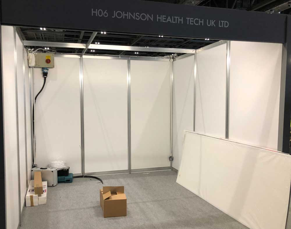 Image showing an empty shell scheme exhibition booth ready to be personalised in a blog post about shell scheme inspiration from QPS Print Stoke-on-Trent