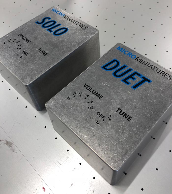 Image of printing on metal preformed cases used for engineering in a blog post from QPS Print Stoke about metal printing