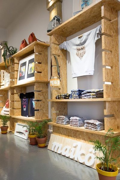QPS Prints On Wood Panels - image of a wooden retail stand in a blog post about wooden printing by QPS Print